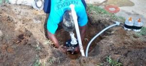 pump service technician repairing a pump image